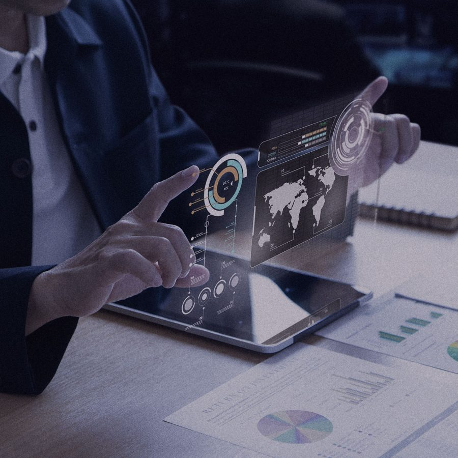 Business man or analyst expanding futuristic investment virtual screen over a modern tablet. Showing if charts and infographic for investment analysis.